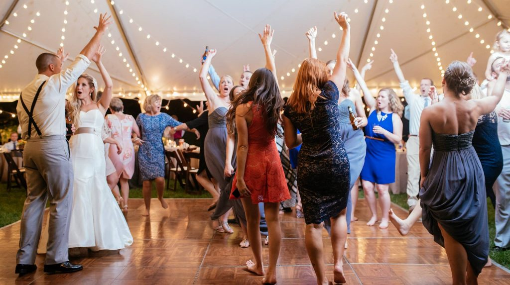 Happy bride and groom on the dance floor during a Knoxville wedding reception with Wedding DJ Michael Durham